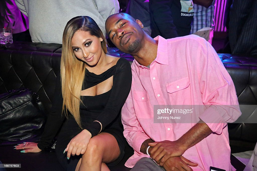 <a gi-track='captionPersonalityLinkClicked' href=/galleries/search?phrase=Adrienne+Bailon&family=editorial&specificpeople=540286 ng-click='$event.stopPropagation()'>Adrienne Bailon</a> and Serius Jones attend the Bronx Charter School for the Arts 2013 art auction at Marquee on May 14, 2013 in New York City.