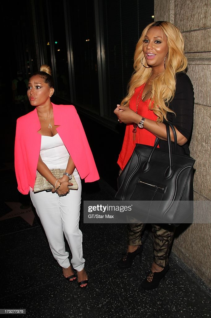 Adrienne Bailon and Tamar Braxton as seen on July 10, 2013 in Los Angeles, California.
