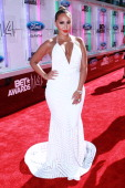 Adrienne Bailon arrive at the BET Make A Wish Foundation Recipient Wish To Attend BET Awards Red Carpet Arrivals on June 29 2014 in Los Angeles...