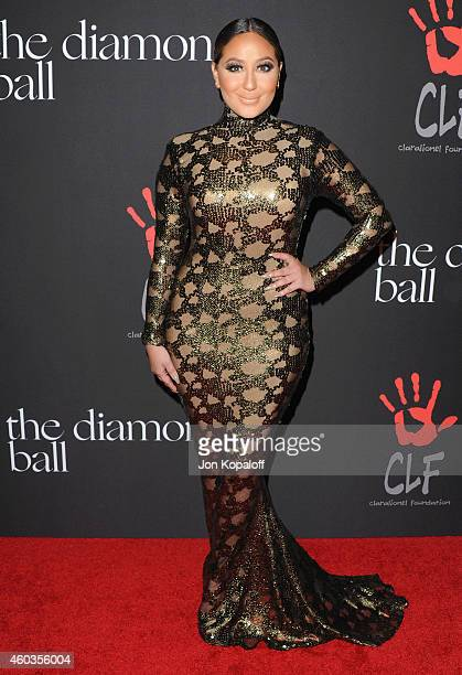 Adrienne Bailon arrives at Rihanna's First Annual Diamond Ball at The Vineyard on December 11 2014 in Beverly Hills California