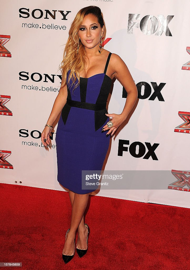 Adrienne Bailon arrives at the 'The X Factor' Viewing Party Sponsored By Sony X Headphones at Mixology101 & Planet Dailies on December 6, 2012 in Los Angeles, California.