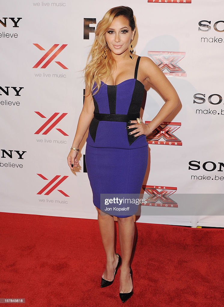 <a gi-track='captionPersonalityLinkClicked' href=/galleries/search?phrase=Adrienne+Bailon&family=editorial&specificpeople=540286 ng-click='$event.stopPropagation()'>Adrienne Bailon</a> arrives at The X-Factor Viewing Party at on December 6, 2012 in Los Angeles, California.