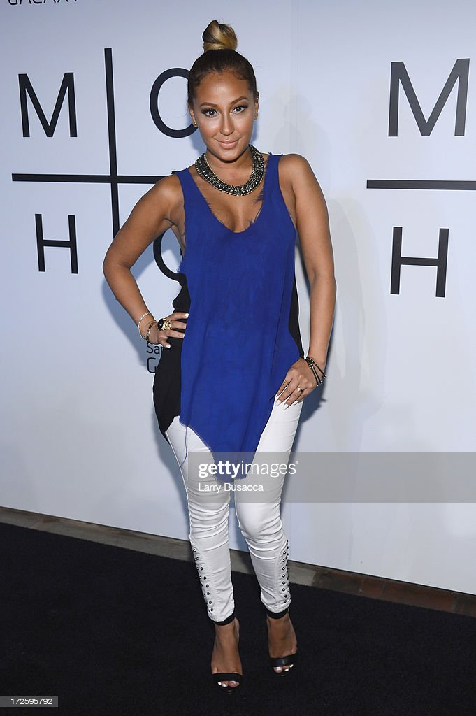 Adrienne Bailon attends JAY Z and Samsung Mobile's celebration of the Magna Carta Holy Grail album, available now through a customized app in Google Play and Samsung Apps exclusively for Samsung Galaxy S 4, Galaxy S III and Note II users on July 3, 2013 in Brooklyn City.