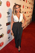 Adrienne Bailon attends the annual Midnight Grammy Brunch hosted by NeYo and Malibu Red at Lure Nightclub on January 26 2014 in Hollywood California