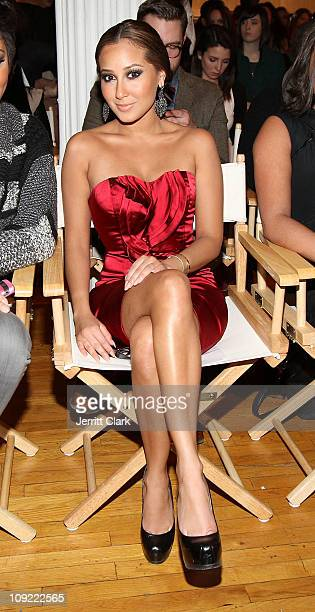 Adrienne Bailon attends the Bebe Fall 2011 fashion show at Style360 on February 16 2011 in New York City