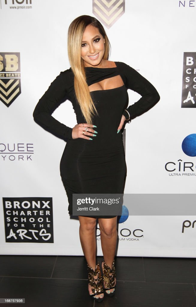 <a gi-track='captionPersonalityLinkClicked' href=/galleries/search?phrase=Adrienne+Bailon&family=editorial&specificpeople=540286 ng-click='$event.stopPropagation()'>Adrienne Bailon</a> attends the Bronx Charter School for the Arts 2013 art auction at Marquee on May 14, 2013 in New York City.