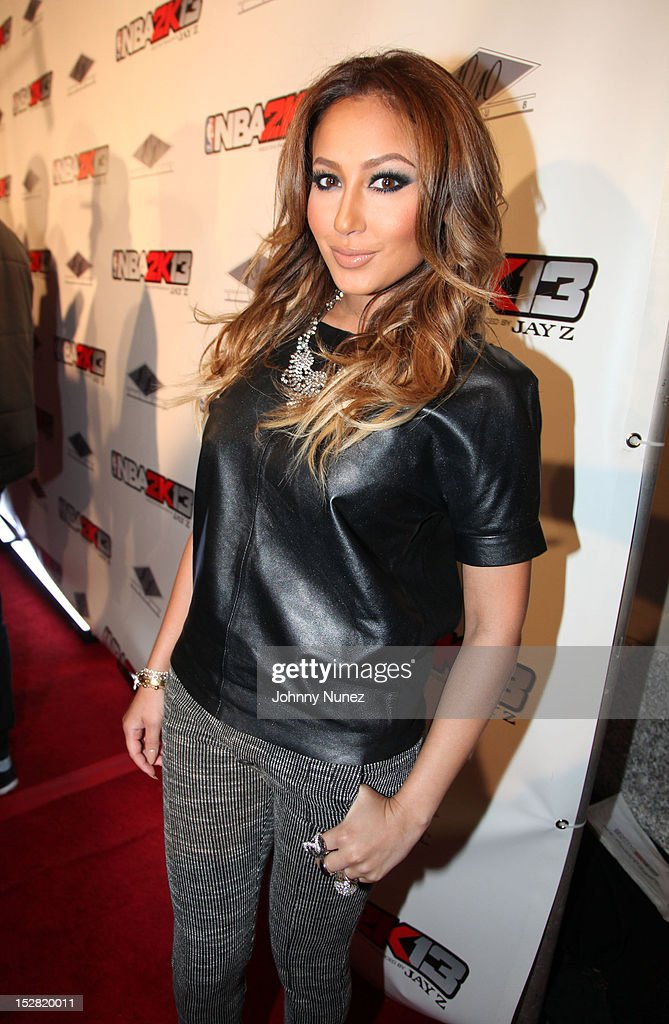 <a gi-track='captionPersonalityLinkClicked' href=/galleries/search?phrase=Adrienne+Bailon&family=editorial&specificpeople=540286 ng-click='$event.stopPropagation()'>Adrienne Bailon</a> attends the Premiere Of NBA 2K13 With Cover Athletes And NBA Superstars at 40 / 40 Club on September 26, 2012 in New York City.