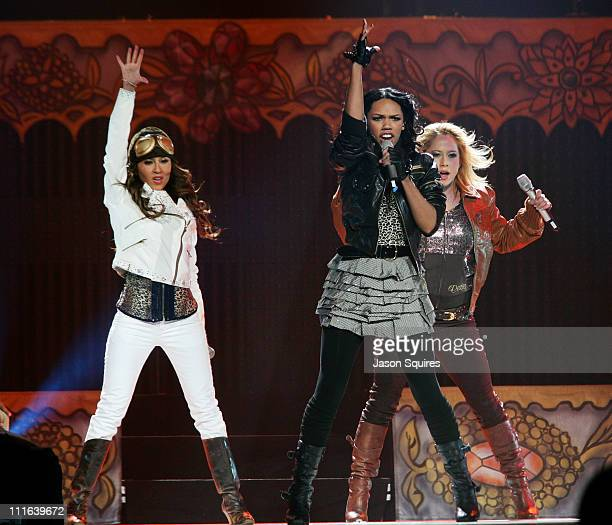 Adrienne Bailon Kiely Williams and Sabrina Bryan of The Cheetah Girls perform at Sprint Center on December 9 2008 in Kansas City Missouri