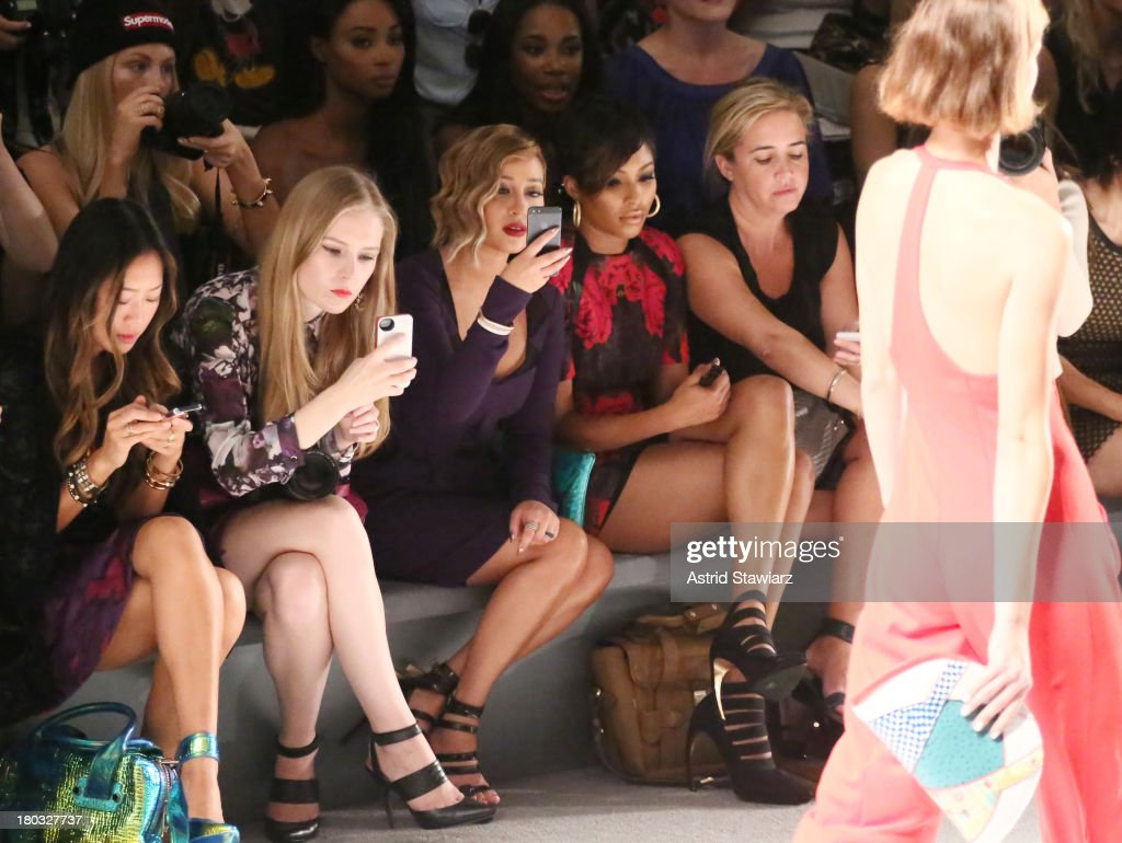 <a gi-track='captionPersonalityLinkClicked' href=/galleries/search?phrase=Adrienne+Bailon&family=editorial&specificpeople=540286 ng-click='$event.stopPropagation()'>Adrienne Bailon</a> (C) sits front row with TRESemme at the Nanette Lepore fashion show during Mercedes-Benz Fashion Week Spring 2014 at The Stage at Lincoln Center on September 11, 2013 in New York City.