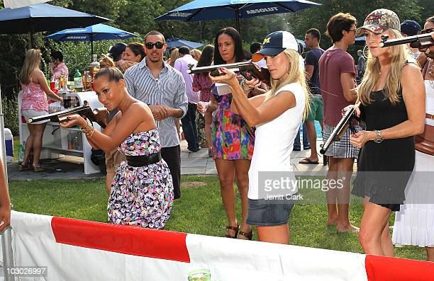 Adrienne Bailon Tinsley Mortimer and Dabney Mercer play the Shotgun Challenge at the Absolut Brooklyn BBQ at The Estate on July 17 2010 in Sag Harbor...