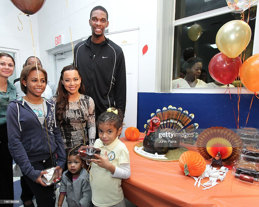 Adrienne Bosh and <a gi-track='captionPersonalityLinkClicked' href=/galleries/search?phrase=Chris+Bosh&family=editorial&specificpeople=201574 ng-click='$event.stopPropagation()'>Chris Bosh</a> attend the 2nd year with the Chapman Partnership to help feed the local families of Miami this Thanksgiving at Chapman Partnership on November 20, 2012 in Miami, Florida.