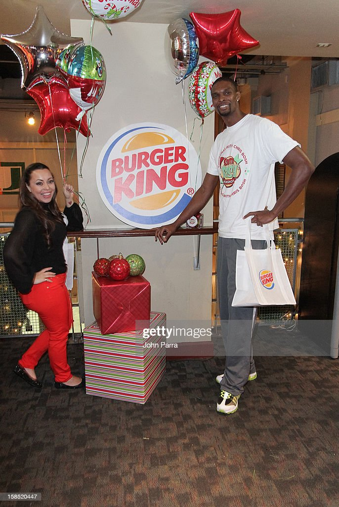 Adrienne Bosh and Chris Bosh during the Christmas With Chris Bosh At 'Santa Bosh's Workshop at Game Time at Sunset Place on December 17, 2012 in Miami, Florida.