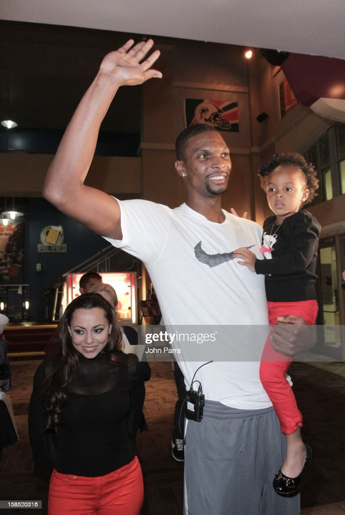 Adrienne Bosh, Chris Bosh and Trinity Bosh arrive at the Christmas With Chris Bosh At 'Santa Bosh's Workshop at Game Time at Sunset Place on December 17, 2012 in Miami, Florida.