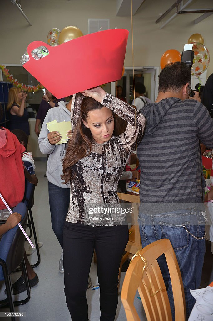 Adrienne Bosh with husband Chris Bosh and Team Tomorrow Inc. team up for the 2nd year with Chapman Partnership to feed the local families of Miami this Thanksgiving on November 20, 2012 in Miami, Florida.