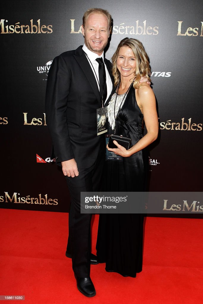 Adrienne Ferreira and Rob Carlton walk the red carpet during the Australian premiere of 'Les Miserables' at the State Theatre on December 21, 2012 in Sydney, Australia.