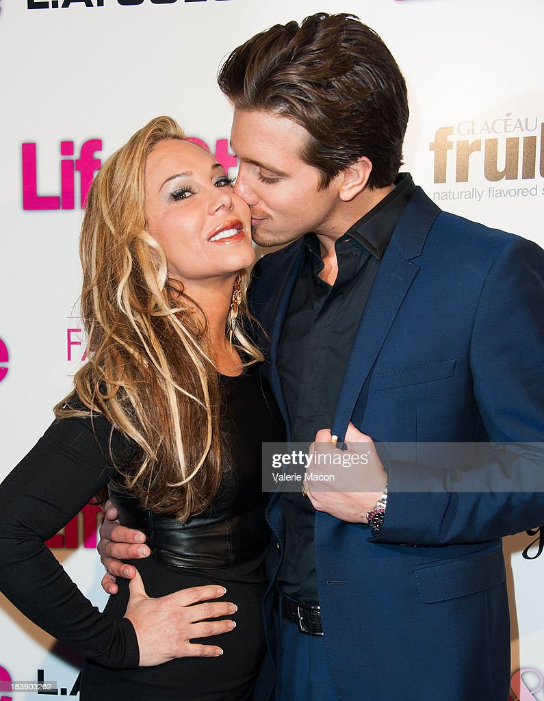 Adrienne Maloof and Jacob Busch arrives at Life & Style's Hollywood In Bright Pink Event Hosted By Giuliana Rancic at Bagatelle on October 9, 2013 in Los Angeles, California.