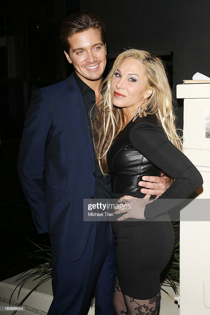 Adrienne Maloof and new boyfriend, Jacob Busch arrive at Life & Style presents 'Hollywood In Bright Pink' held at Bagatelle on October 9, 2013 in Los Angeles, California.