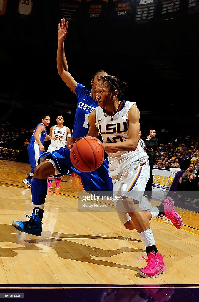 Adrienne Webb of the LSU Tigers drives around A'dia Mathies of the Kentucky Wildcats during a game at the Pete Maravich Assembly Center on February...