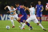 Adrijan Ademi of Croatia is challenged by Jose Del Aguila and Jose Castillo of Guatemala during the FIFA U20 World Cup 2011 Group D match between...