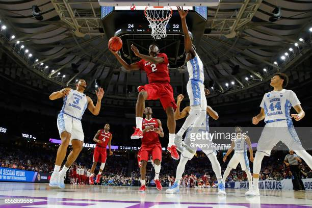 Adrio Bailey of the Arkansas Razorbacks drives to the basket in the first half against the North Carolina Tar Heels during the second round of the...