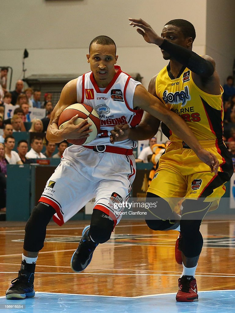 Adris Deleon of the Hawks is challenged by Jonny Flynn of the Tigers during the round eight NBL match between the Melbourne Tigers and the Wollongong Hawks at State Netball Hockey Centre on November 25, 2012 in Melbourne, Australia.