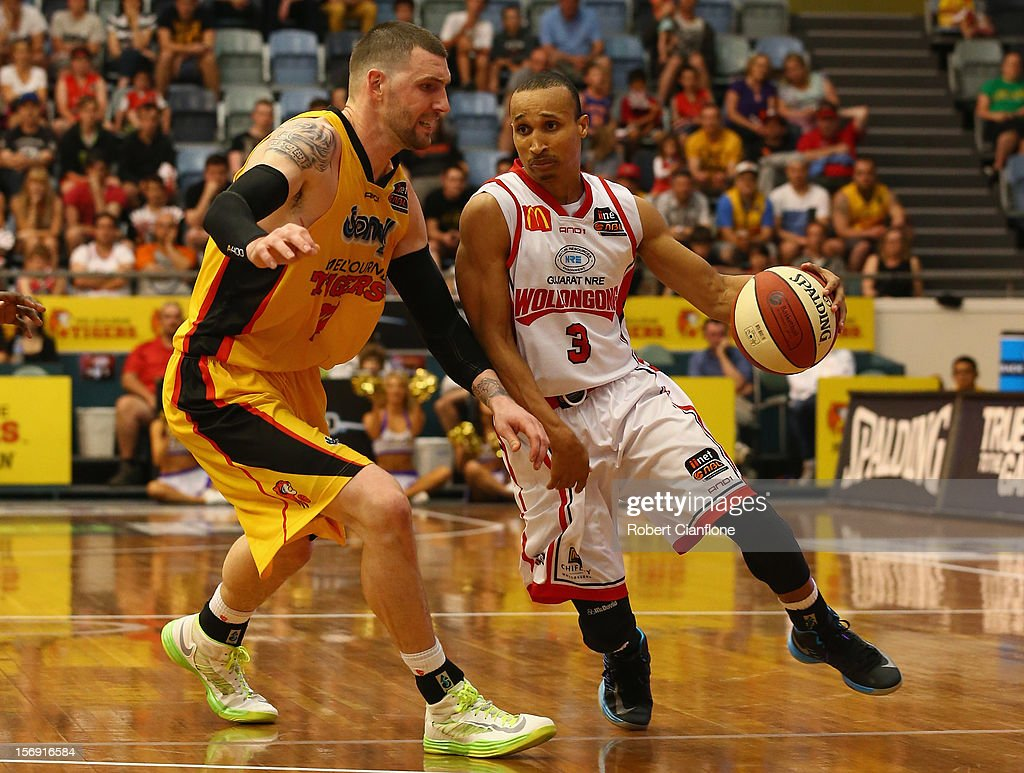 Adris Deleon of the Hawks is challenged by Seth Scott of the Tigers during the round eight NBL match between the Melbourne Tigers and the Wollongong Hawks at State Netball Hockey Centre on November 25, 2012 in Melbourne, Australia.