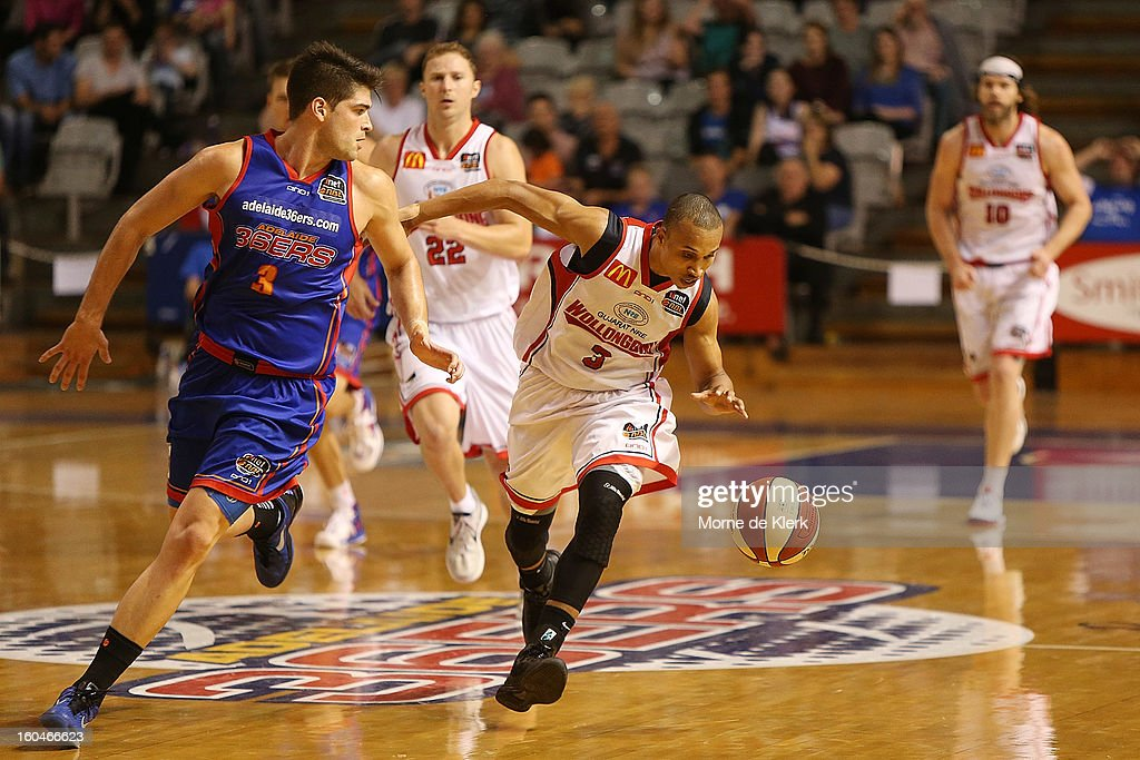 Adris Deleon (C) of Wollongong moves the ball forward as Stephen Weigh of Adelaide defends during the round 17 NBL match between the Adelaide 36ers and the Wollongong Hawks at Adelaide Arena on February 1, 2013 in Adelaide, Australia.