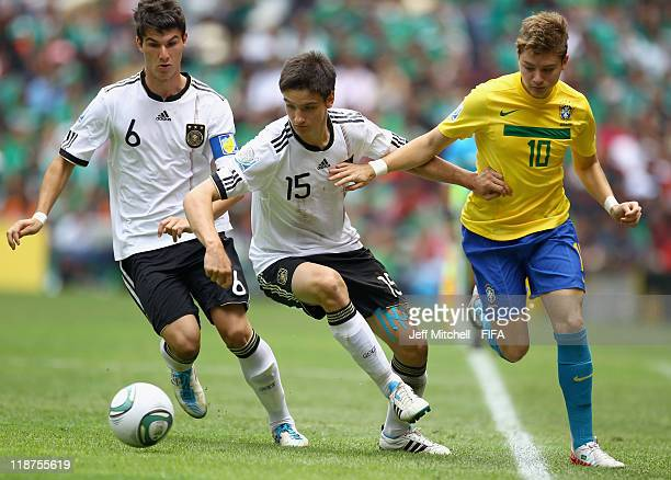 Adryan of Brazil is closed down by Noah Koezowski and Robin Yalcin of Germany during the FIFA U17 World Cup Mexico 2011 3rd Place Playoff match...