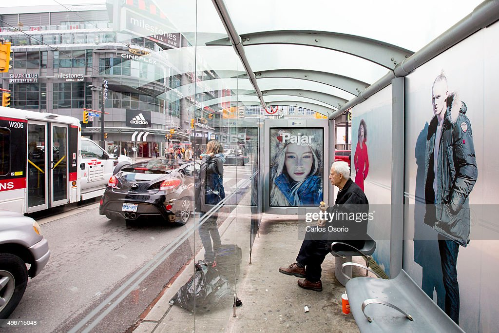 TORONTO ON NOVEMBER 11 Ads for expensive winter coats at the same Yonge and Dundas bus shelter where a homeless man died in a tshirt last winter have...