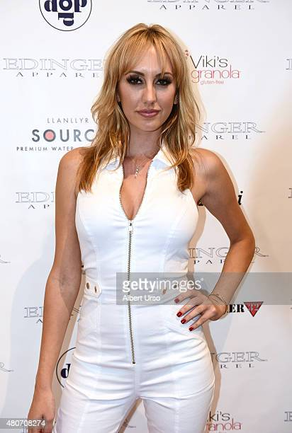 Adult actress Brett Rossi walks the red carpet at the Edinger Apparel presentation during New York Fashion Week Men's SS16 at Rogue Space on July 14...
