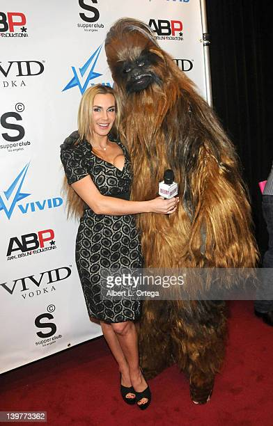 Adult actress Tanya Tate and Chewbacca arrive for the Premiere Of Vivid Entertainment's 'Star Wars XXX A Porn Parody' held at SupperClub on February...
