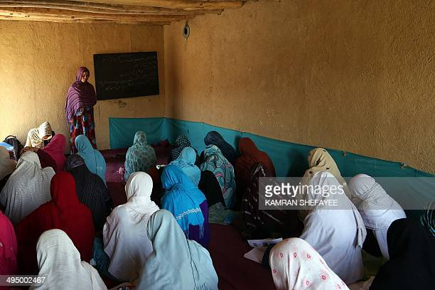 Adult Afghan students attend a literacy class in Bamiyan province on May 31 2014 Some 60 literacy training centres funded by UNICEF hold active...