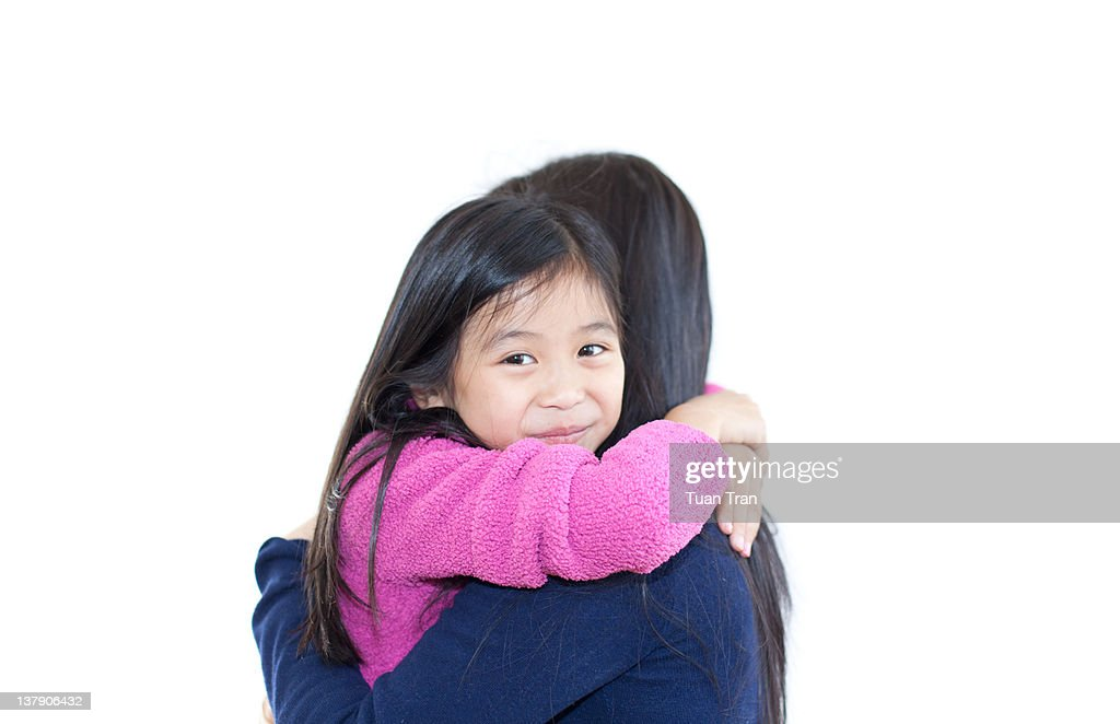 Adult and child hugging : Stock Photo