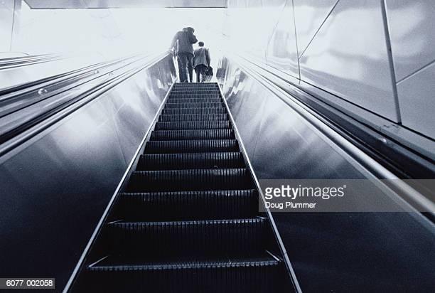 Adult and Child on Escalator