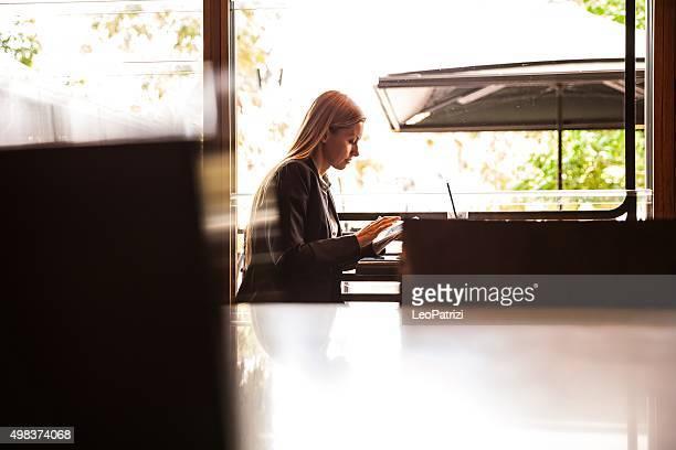 Adult businesswoman having a break in a restaurant