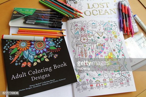 Adult Coloring Books and variety of pencils, pens and markers