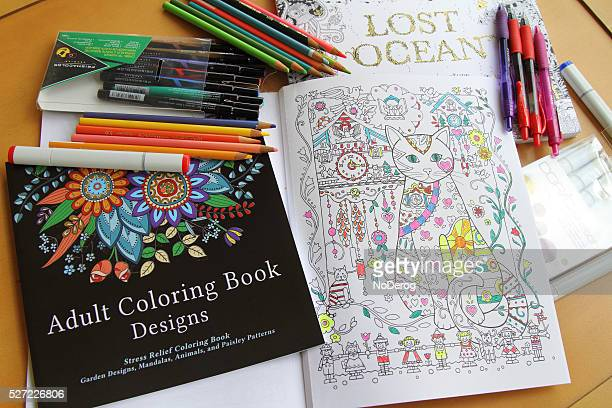 adult coloring books and variety of pencils pens and markers - Coloring Book Paper Stock