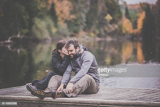 Adult Couple Having Fun On Wooden Dock