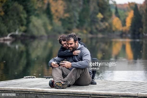 Adult Couple Having Fun On Wooden Dock