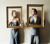 Adult couple holding up frames