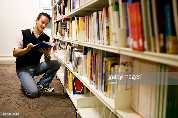 adult education: mature student using his college reference library