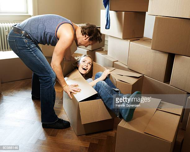 Adult female being packed into moving box