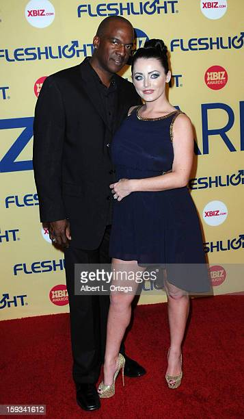 Adult Film actor Lee Bang and adult film actress Sophie Dee arrive for the 2013 XBIZ Awards held at the Hyatt Regency Century Plaza on January 11...