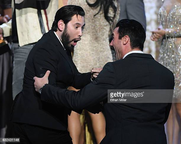 Adult film actor/director Tommy Pistol and adult film actor Charles Dera react as they walk to the stage to accept the award for Movie of the Year...