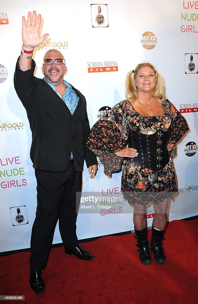 Adult film actors James Bartholet and Ginger Lynn arrive at the premiere of 'Live Nude Girls' held at Avalon on August 12, 2014 in Hollywood, California.