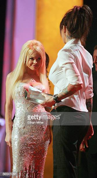 Adult film actress and show cohost Jesse Jane looks over at actress Janine Lindemulder after they won the Best AllGirl Sex Scene Video award at the...