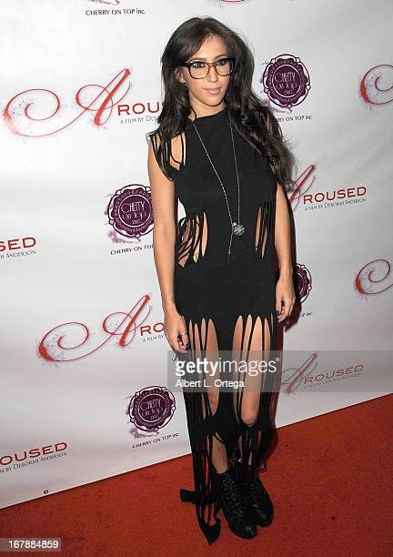 Adult film actress April O'Neil arrives for the Premiere Of 'Aroused' held at Landmark Nuart Theatre on May 1 2013 in Los Angeles California