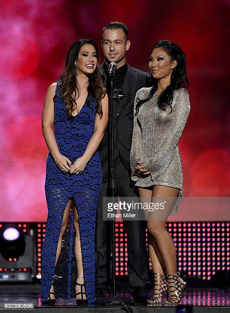 Adult film actress Eva Lovia adult film actor Chad White and adult film actress/director Asa Akira present an award during the 2017 Adult Video News...