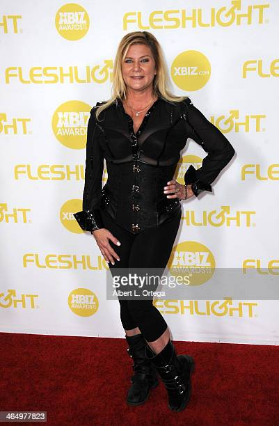 Adult film actress Ginger Lynn Allen arrives for the 2014 XBIZ Awards held at The Hyatt Regency Century Plaza Hotel on January 24 2014 in Century...