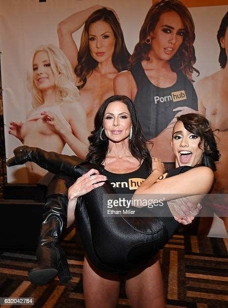 Adult film actress Kendra Lust picks up adult film actress Janice Griffith at the Pornhub booth at the 2017 AVN Adult Entertainment Expo at the Hard...
